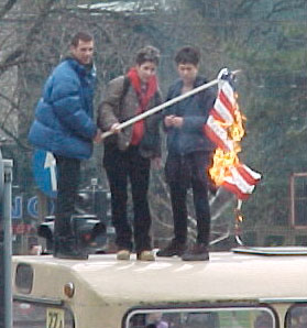 Belgrade youth burns American flag